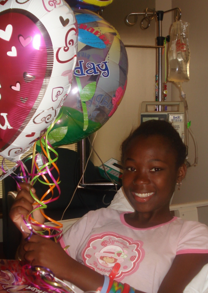 Young female patient holding balloons